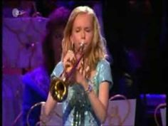 The Last Post (il silencio) Melissa Venema (14 yrs old) has terrific breath power. She is accompanied by Andre Rieu and his orchestra. Beautiful!