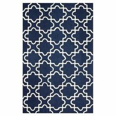 """Anchor your living room seating group or define space in the den with this artfully hand-hooked rug, featuring a geometric tile motif for eye-catching appeal.  Product: RugConstruction Material: 100% PolyesterColor: NavyFeatures: Hand-hookedPile Height: 0.5"""" Note: Please be aware that actual colors may vary from those shown on your screen. Accent rugs may also not show the entire pattern that the corresponding area rugs have.Cleaning and Care: Spot treat with a mild detergent and water. ..."""