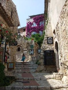 Eze, France - a medieval hilltop town with an ocre cathedral and stately clock tower. It's a village for tourists, full of galleries, boutique s, restaurants, and, of course, the beach.