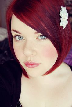 Beautiful cranberry red hair in a very lovely bob, complemented with a cute flower clip!