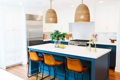 """""""Our goal was to create a mashup of coastal-boho-preppy styles...that's a thing, right? We mixed white walls, navy accents and stripes, with vintage rugs, leather and natural wood tones. The result is bright, eclectic and filled with lots of good vibes."""""""
