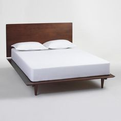 Bring home contemporary versatility with our platform bed featuring solid wood construction with rich graining and a classic walnut finish. A clean silhouette and conical legs give this frame and headboard a mid-century modern look. Cama Queen, Queen Beds, Modern Bedroom Furniture, Bed Furniture, Furniture Knobs, Modern Bedding, Mid Century Modern Bedroom, Yellow Bedding, Wood Platform Bed