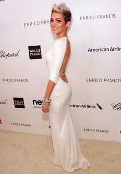 Nice dress Miley, too bad your performance at the MMA's was disgraceful.
