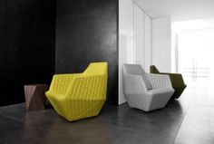 The Monolithic Facett armchair by the Bouroullec bros. 2005. It is available in a swivel version and a wide range of complementary fabrics.