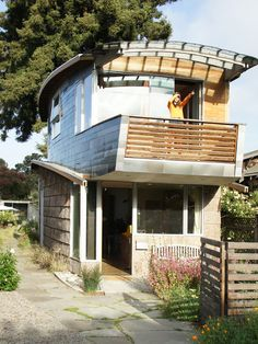 Simple-eclectic-exterior-of-self-sustain-home-with-wooden-fence-and-stone-brick-wall-in-unique-self-sustaining-homes-design – Primadr on We Heart It