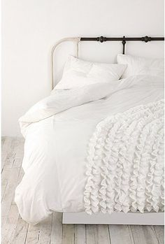 Learn to ruffle. Buy cheap IKEA duvet cover, second hand sheets and ruffle up some bedding
