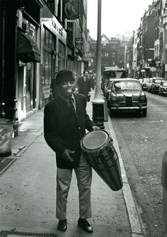 This is Speedy Acquaye on Gerrard Street in Soho. He was a Ghanian drummer. He had been in London since the 50s. Everyone on the jazz scene knew him. He was a Soho character—he knew every nook and cranny of the area. He worked with Georgie Fame and The Blue Flames at the Flamingo Club in Wardour Street.