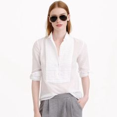 J.Crew Swiss dot tuxedo shirt Light, crisp and airy, this top was such a crowd-pleaser that we had to bring it back from our archives. We love the mix of summery swiss-dot with a polished pleated bib, a nod to men's formalwear. Cotton. Long sleeves. New with tags and never worn. Great with shorts for the summer!! J. Crew Tops Blouses