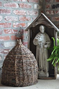 St. Francis watching over all things great (like this bee skep) and small.