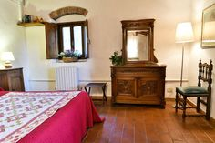 Red, wood and Tuscan cotto for the floor, the perfect country style #chainti #tuscany #italy