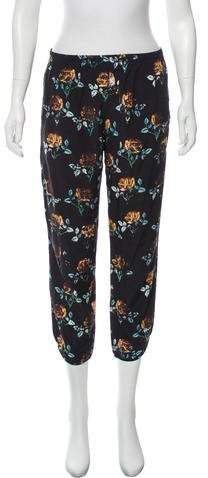 Black and multicolor Thakoon Addition mid-rise floral silk jogger with four pockets and elastic trim. Silk Joggers, Athletic Pants, Collars, Pajama Pants, Slim, Legs, Floral, Skirts, Sleeves