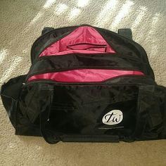 Double pocket gym bag Two large zipper compartments, side water bottle pockets, front zippered pocket. Is stamped with TW logo the upscale gym and spa it came from. Use for gym, travel or even a diaper bag. Excellent condition. Bags