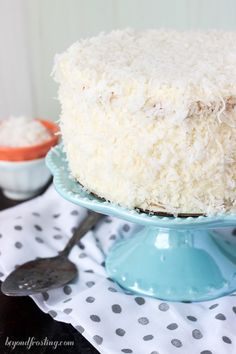 This Coconut Custard Cake is layers of coconut cake, with a coconut custard filling and finished with a cream cheese icing. This from-scratch recipe is easy and full of flavor. Coconut Custard, Custard Cake, Custard Filling, No Bake Desserts, Just Desserts, Dessert Recipes, Cookie Recipes, Perfect White Cake Recipe, Angle Food Cake Recipes