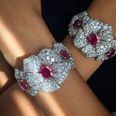 Cartier Ruby and diamond bracelets, with yellow gold and diamond backchains, circa 1960.