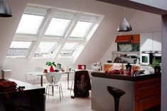 contemporary window designs for small interiors with an inclined roof