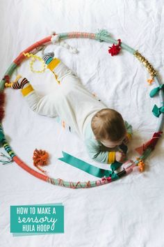 How to make a sensory hula hoop for baby-posted by Jamie I saw this photo on facebook about a year ago, and couldn't get it out of my brain. Tummy time is so important, but not all babies love laying on their belly. I hope the sensory hula hoop allows your baby to enjoy tummy time more. And possibly keeps the little nugget busy for a few extra seconds to give you time to flip through the magazine you've been dying to read. As always, I recommend supervising your baby while playing with the