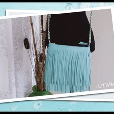 "Fringe Cross over bag Turquoise Both side fringe Medium crossbody. Made of faux leather. Shoulder strap adjustable up to 25"" drop length- chain strap. Fully lined. Closure zipper top. Interior- 1 zipper pocket and 2 slip pockets. Size: 9.5""L x 1""W x 7""H (11"" length fringes) Boutique Bags Crossbody Bags"