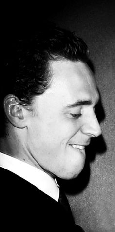 There is something about when a man bites his bottom lip.   Tom Hiddleston