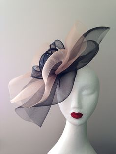 Mad Miss Hatty black and nude crinoline fascinator with rolled sinamay loops. Statement piece for the races or a wedding. Find me on facebook.
