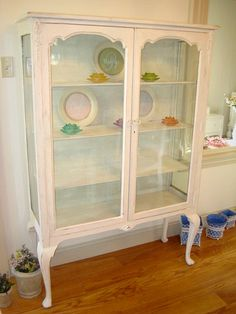 China Cabinet. Like The lines/ Queen Ann legs. Prefer the wood to be stained instead of white paint.