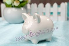 Free Shipping 100box Ceramic Mini-Piggy Bank in Gift Box with Polka-Dot Bow TC018             http://aliexpress.com/store/product/Free-Shipping-100box-Pink-Flip-Flop-Bottle-Opener-wedding-bomboniere-WJ058-B/513753_1719869702.html  #babyshower #souvenirs #beterwedding  #bomboniere #partygifts   #partydecoration #beachparty #kidsbirthday