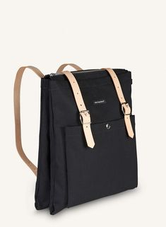 Meander on two wheels or two feet wearing the smart Eppu backpack. It's comprised of two cavities divided by a handy pocket, topped with a zip closure. The heavyweight canvas and reinforced interior seams make Eppu durable, and the two a Tote Backpack, Black Backpack, Marimekko Bag, Black And White Bags, Moda Fashion, Casual Bags, My Bags, School Bags, Michael Kors Jet Set