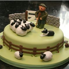 Marzipan-made sheep herder decorated cake
