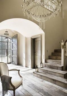 Beautiful entrance hallway with an incredible chandelier, a mixture of glamour and rustic floors and magnificent lines. Love it
