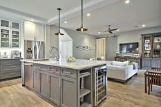 www.avenuebdev.com #kitchen #gray #island #openlayout #pendant #subwaytile #Countertops #woodfloor