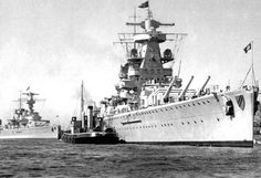 11 in 'pocket battleships' Admiral Scheer (foreground) and Lutzow (originally Deutschland) in 1939. Lutzow, the first sister, lacked the tower bridge of Scheer and the third ship, Admiral Graf Spee - later removed from Scheer when she and Lutzow were re-designated as heavy cruisers in 1940. Graf Spee was sunk in December 1939.