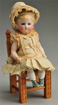 Bisque doll with green boots (Kestner?)