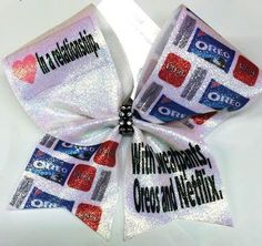 Bows by April - In a Relationship with Netflix Oreos and Sweatpants Cheer Bow, $15.00 (http://www.bowsbyapril.com/in-a-relationship-with-netflix-oreos-and-sweatpants-cheer-bow/)