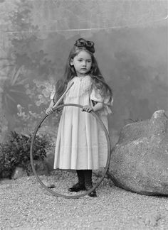 vintage photo of little girl with hoop