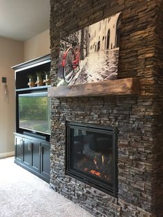 reclaimed wood fireplace google search see more chapel hill stacked stone fireplace surround with custom built in tv cabinet to the side of