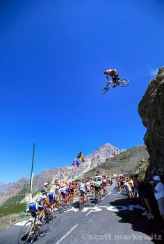 Statement! Tour de France 2003: Whack job on a mountain bike jumping the cycling peloton.