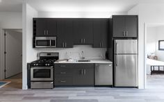 These apartments in Logan Square have all new kitchens with white quartz counters, flat panel kitchen cabinets, and undermount sinks Small Kitchen Plans, Small Basement Kitchen, Kitchen Layout Plans, One Wall Kitchen, Wood Floor Kitchen, Small Kitchen Cabinets, Ikea Kitchen Design, Small Kitchen Layouts, Kitchen Interior
