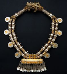 Necklace from Oman Oman Silver, gold leaf, silver pointed beads, Maria Theresia thalers Late 19th century Height 50cm