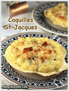 Seafood in a creamy béchamel sauce covered with cheese and mashed potatoes piped around the edges, a must have for Christmas Eve! #coquillesstjacques