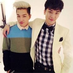 Seungri takes a picture with fellow Big Bang member Taeyang | http://www.allkpop.com/article/2014/01/seungri-takes-a-picture-with-fellow-big-bang-member-taeyang