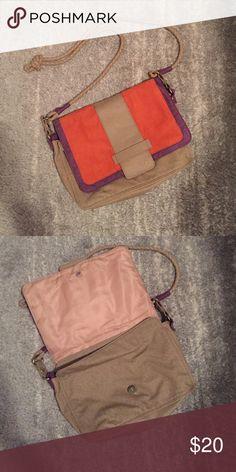 Color block cross body Lulu (Nordstrom brand) cross body purse. Front features bright orange and purple color blocking. Main purse color is tan. Features braided strap. There is some wear- inside snap that closes front flap is broken off. Nordstrom Bags Crossbody Bags