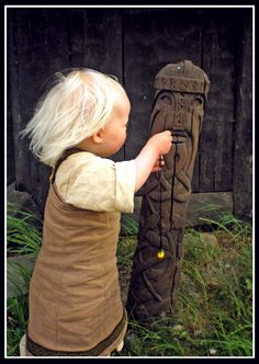 instinct!!The offering: Hervor, hanging her necklace around a wooden God. The father had no idea she would do that, a photo taken at a great moment.