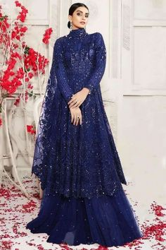 A stylish interpretation of ethnic glamour and contemporary style, this royal blue net sharara suit which will make you ready to make a statement in the upcoming occassion. This closed neck and full sleeve party wear attire perfectly formed using thread work. Completed with net sharara pants in royal blue color with royal blue net dupatta. Sharara pants has stone work. #shararasuits #malaysia #Indianwear #weddingwear #andaazfashion Indian Attire, Indian Wear, Pantalon Cigarette, Sharara Suit, Wear Store, Royal Blue Color, Wedding Wear, Costume, Party Wear