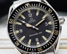 Omega Seamaster 300 165.024, 165024, stainless steel on a stainless steel Omega bracelet (1171)), automatic movement (Caliber 552), centered sweep second hand, original black dial with perfectly matching aged indexes and sword hands, original bezel is showing nice patina on the numbers, 24.7M movement serial (circa 1966), diameter: 41 mm, thickness: 12.5 mm, Excellent Condition with European Watch Company Pouch and 6 Month Warranty.