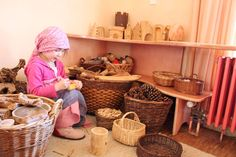 surrounded by baskets and little benches. the simplicity of it is inspiring.