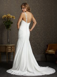 This chiffon fashion has one shoulder strap that extends from the sweetheart neckline and the same gorgeous beading travels to the opposite side of the slender gown to give a touch of bling to your dress. Allure Romance 2515 is a slender gown with charm and lots of ruching through the torso #timelesstreasure