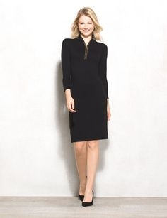Studs lend a little edge to a cool-weather favorite. Throw some zippered details into the mix and you have one must-have sweater dress for fall. Zipped studded neckline. Imported.