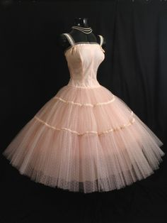 Vintage 1950's baby pink tulle, taffeta and velvet dress!  So my style, I would wear this in a heart beat!  In fact, I saw a similiar dress in one of the antique malls in Duncan, Okla,(2/8/12) $85...Paired with a pair of ballet slippers!  Perfect for prom, for the girl who marches to the beat of her own drum!