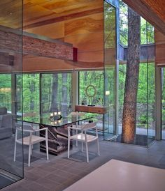 House built around the trees. Love the beam finish matching the trees