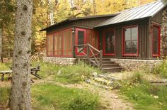 Brown cabin with red trim