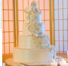 Four-tiered, all-white confection had a special surprise inside -- red velvet cake.